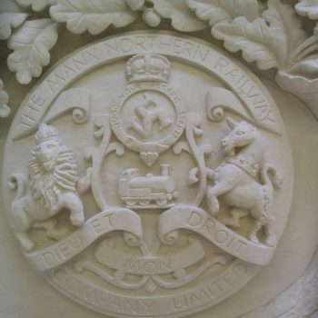 Carved-Crests-of-Gothic-Revival-Fireplace,-Surrey