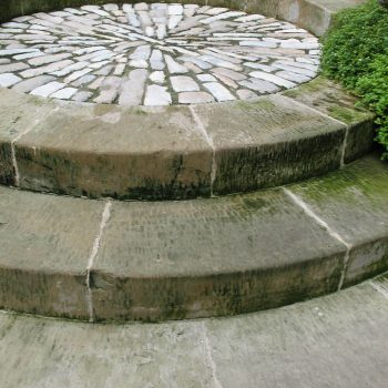 Deliberatly-rustic-steps-and-French-reclaimed-cobbled-landing-in-West-Hoathly
