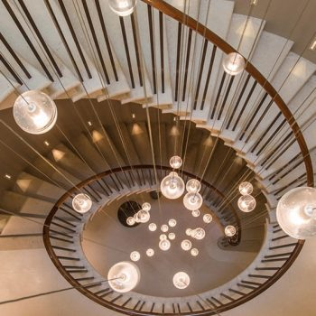 Elliptical-Cantilevered-Staircase-in-Massangis-Beige-Clair