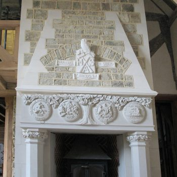 Heavily-Carved-and-Enriched-Gothic-Revival-Fireplace,-Surrey