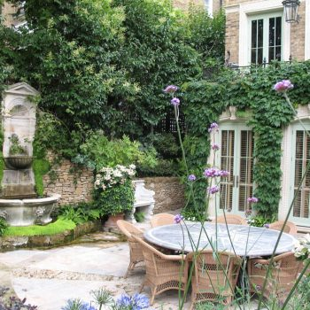 Romantic-garden-with-window-surrounds,-hard-lanscaping-and-furniture-in-a-range-of-stones-and-treatments-(2)