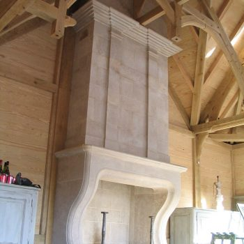 Baronial-Stone-Fireplace-in-Antiqued-Massangis-Jaunne-French-Limestone-(2)