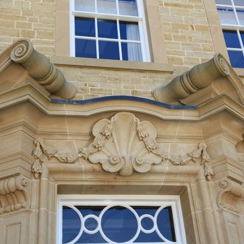 Carved-stone-entrance-in-Blaxters-Buff
