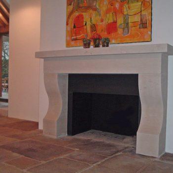Contemporary-Fireplace-in-Moca-Creme-Portuguese-Limestone,-Surrey