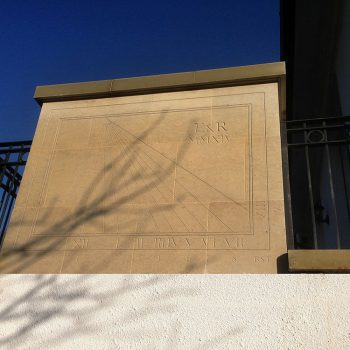 Hand-cut-sundial-in-Stoke-Ground-Base-Bed