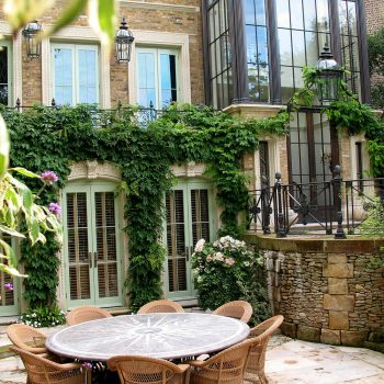 Romantic-garden-with-window-surrounds,-hard-lanscaping-and-furniture-in-a-range-of-stones-and-treatments